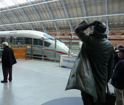 Sir John Betjeman statue and ICE train at St Pancras station on Tuesday 19th October 2010. © Robert Carr